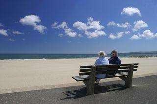 Elderly Couple on Beach Bench
