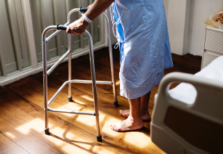 Hospital patient with walker